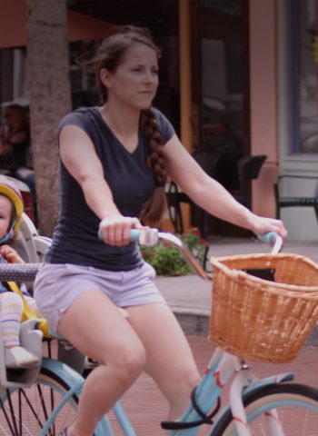 mother and child riding bike