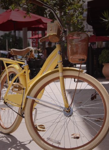 yellow bicycle on sidewalk