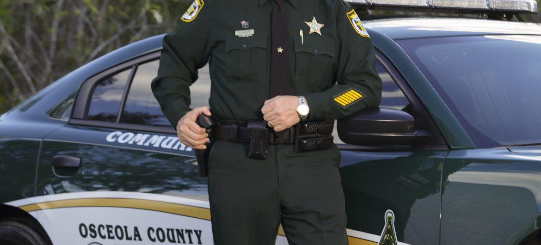 Sheriff Gibson next to patrol car